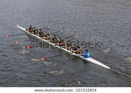 BOSTON - OCTOBER 19, 2014: Fenerbah�§e rowing of Istanbul Turkey races in the Head of Charles Regatta Men's Championship Eights, Craftsbury Sculling Center won with a time of 14:20 - stock photo