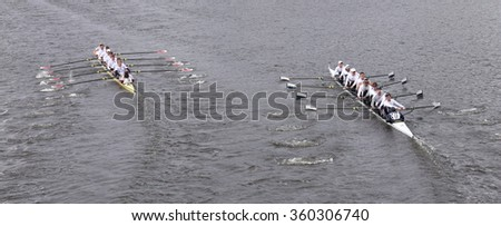 BOSTON - OCTOBER 18, 2015: Harvard (left) and Yale (right) races in the Head of Charles Regatta Men's Master Eights [PUBLIC RACE]