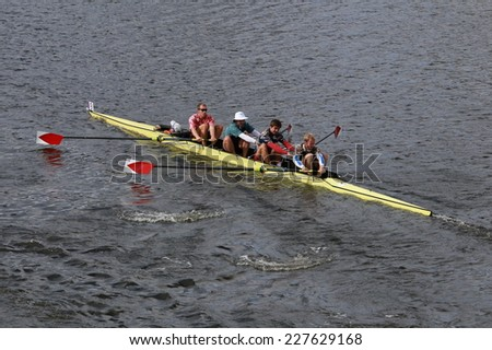 BOSTON - OCTOBER 19, 2014: Harvard University races in the Head of Charles Regatta Men's Championship Fours - stock photo