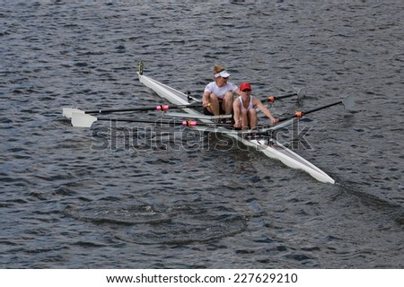 BOSTON - OCTOBER 19, 2014:Lake Union Rowing with Leslie Mittendorf and Melissa Pearlstein races in the Head of Charles Regatta women's Doubles - stock photo