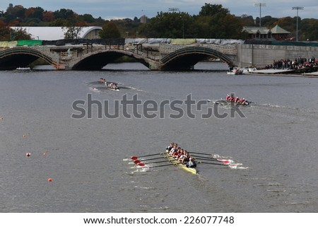 BOSTON - OCTOBER 19, 2014: Many Teams (Eyre Rowing Bottom) race in the Head of Charles Regatta Men's Championship Eights, Craftsbury Sculling Center won with a time of 14:20 - stock photo