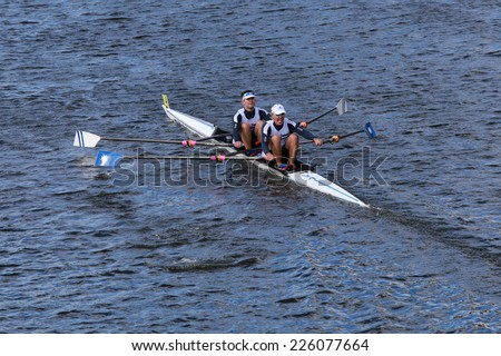 BOSTON - OCTOBER 19, 2014: Matla NARR rowing with Fred Duling and Jeff Brock race in the Head of Charles Regatta Men's Master Doubles, 612endurance Rowing won with a time of 18:58 - stock photo