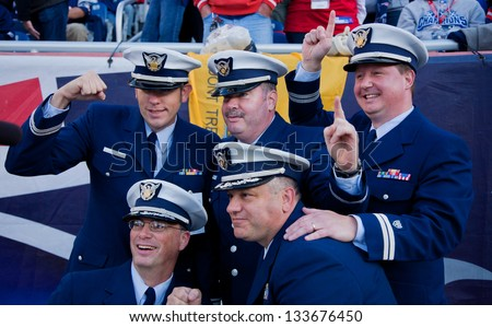 BOSTON - OCTOBER 16: Members of US Coast Guard wearing uniform pose for picture at Gillette Stadium, New England Patriots vs. the Dallas Cowboys on October 16, 2011 in Foxborough, Boston, MA - stock photo