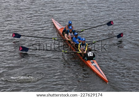 BOSTON - OCTOBER 19, 2014: Nassau rowing races in the Head of Charles Regatta Men's Championship Fours - stock photo
