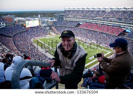 BOSTON - OCTOBER 16: Professional photographer Joseph Sohm at Gillette Stadium, the home of Super Bowl champs, New England Patriots vs. the Dallas Cowboys on October 16, 2011 in Foxborough, Boston, MA - stock photo