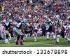 BOSTON - OCTOBER 16: Quarterback Tom Brady, No 12, takes hike at Gillette Stadium, New England Patriots vs. Dallas Cowboys on October 16, 2011 in Foxborough, Boston, MA - stock photo