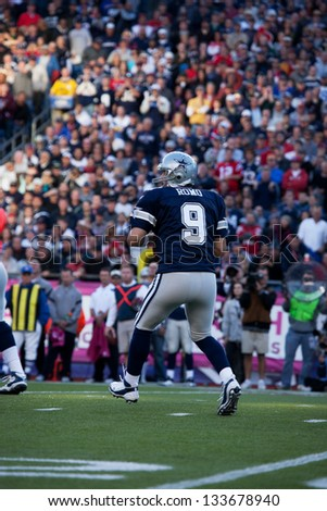 BOSTON - OCTOBER 16: Quarterback Tony Romo, No 9 of Dallas Cowboys, passes football at Gillette Stadium, New England Patriots vs. Dallas Cowboys on October 16, 2011 in Foxborough, Boston, MA - stock photo