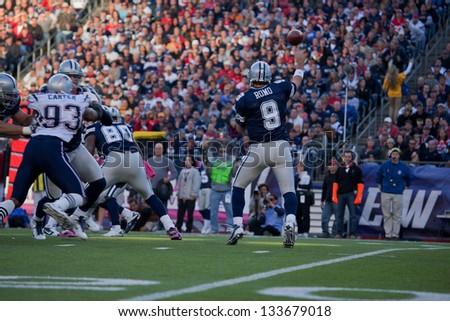 BOSTON - OCTOBER 16: Quarterback Tony Romo, No 9 of Dallas Cowboys, passes footballll at Gillette Stadium, New England Patriots vs. Dallas Cowboys on October 16, 2011 in Foxborough, Boston, MA - stock photo