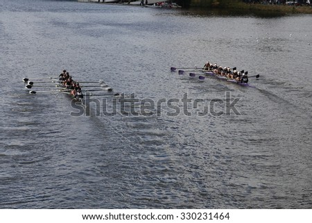 BOSTON - OCTOBER 18, 2015: Rose City Rowing (left) and Mount Saint Joseph (right) races in the Head of Charles Regatta Women's Youth Eights - stock photo