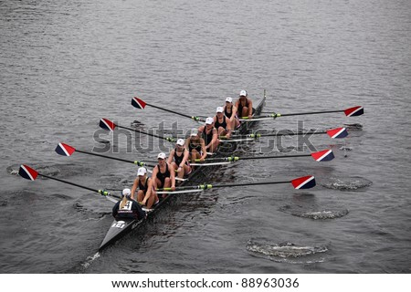 BOSTON - OCTOBER 23: Sammamish Rowing youth womens Eights races in the Head of Charles Regatta. Oakland Strokes won with a time of 17:12 on October 23, 2011 in Boston, MA. - stock photo