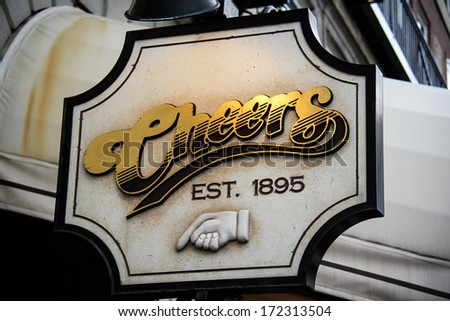 BOSTON -Â?Â? OCTOBER 1, 2011: Sign in front of Cheers, a bar and popular tourist attraction in Boston, Massachusetts. The basis for the popular television series. - stock photo