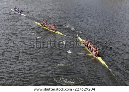 BOSTON - OCTOBER 19, 2014: Sydney (Right), Stanford University Men's Crew (Middle), Washington (Top)  races in the Head of Charles Regatta Men's Championship Fours - stock photo