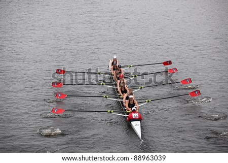 BOSTON - OCTOBER 23: Three Rivers Rowing youth womens Eights races in the Head of Charles Regatta. Oakland Strokes won with a time of 17:12 on October 23, 2011 in Boston, MA. - stock photo
