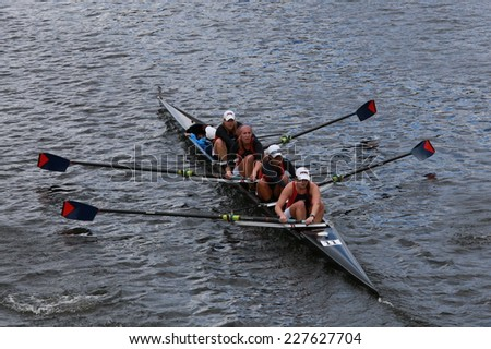 BOSTON - OCTOBER 19, 2014: University of Pennsylvania races in the Head of Charles Regatta women's Championship Fours - stock photo