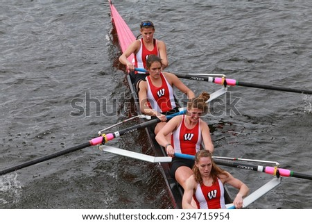 BOSTON - OCTOBER 19, 2014: University of Wisconsin races in the Head of Charles Regatta Women's Championship Eights - stock photo