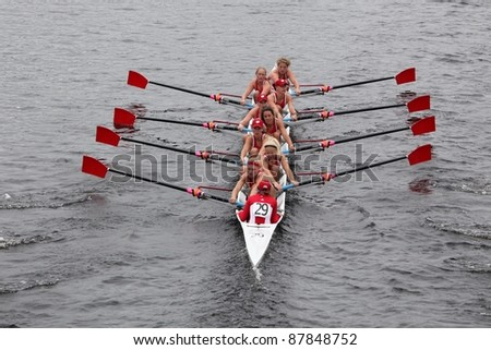 BOSTON - OCTOBER 23: University of Wisconsin women's Eights races in the Head of Charles Regatta. Williams College won with a time of 14:17 on October 23, 2011 in Boston, MA. - stock photo