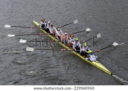 BOSTON - OCTOBER 19, 2014: US Rowing races in the Head of Charles Regatta Women's Championship Eights - stock photo