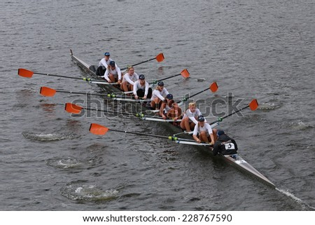 BOSTON - OCTOBER 19, 2014: Virginia University Rowing races in the Head of Charles Regatta Women's Championship Eights - stock photo