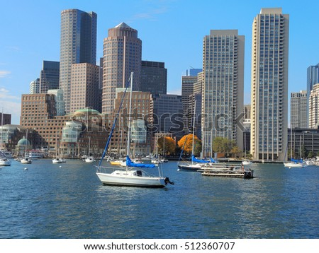 Boston's waterfront skyline with boats in the foreground