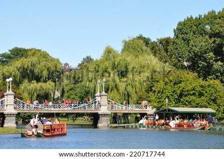 BOSTON - SEP 14: Swan boats at the Public Gardens in Boston, as seen on Sep 14, 2014. The boats are a famous Boston tourist attraction, which began operating in 1877. - stock photo