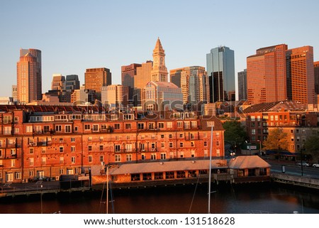 Boston Skyline and Custom House Tower with condos below it at sunrise in Boston, MA - stock photo