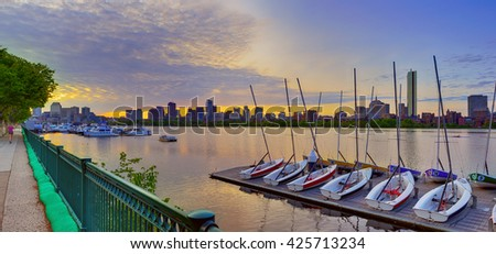 Boston skyline at dawn, boats docked in the Charles and early birds running and rowing - stock photo