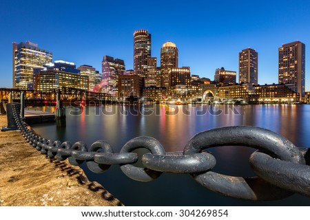 Boston skyline at dusk as viewed from Fan Pier Park. - stock photo