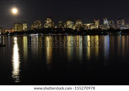 Boston skyline at Full Moon from Harvard University Sailing Center, Boston, MA, USA - stock photo