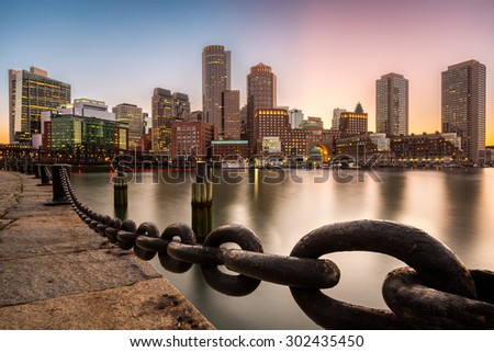 Boston skyline at sunset as viewed from Fan Pier Park. - stock photo
