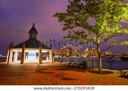 Boston skyline at sunset at Piers Park in Massachusetts USA - stock photo