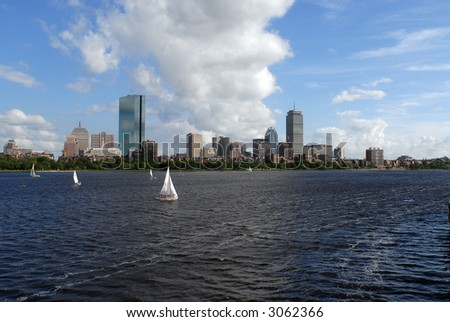 Boston skyline in Summer with sailboats on the Charles