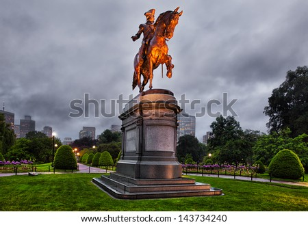 Boston statue of George Washington illuminated on a misty evening. Located at the entry of the Boston Public Garden, the statue is an iconic symbol of the city.