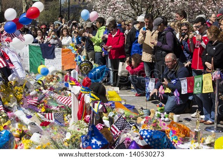 BOSTON, USA - APRIL 21: 1 week after the Boston 2013 Marathon bombing, locals come to Boylston Street's improvised memorials in Boston, MA, USA to pay respect and leave mementos on April 21, 2013.
