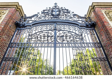 BOSTON, USA - AUGUST 9: the historic architecture of the Harvard University in Cambridge, Massachusetts, USA showcasing its fancy iron gate at sunrise on August 9, 2016.