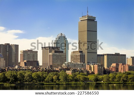 BOSTON, USA - JULY 10: Panoramic view of Boston in Massachusetts, USA showcasing the architecture of its historic and modern buildings with the famous Charles River and gardens on July 10, 2014. - stock photo