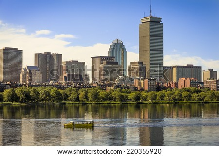 BOSTON, USA - JUNE 10, 2013: Panoramic view of Boston in MA, USA showcasing its mix of modern and historic skyscrapers and some locals going for a ride in the Charles River on June 10, 2013.