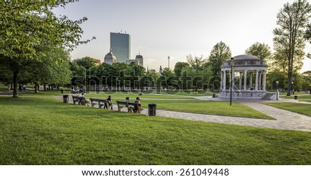 BOSTON, USA - JUNE 15: Panoramic view of Boston in Massachusetts, USA showcasing the architecture of the Boston Public Garden at Beacon Hill with locals passing by on June 15, 2014. - stock photo