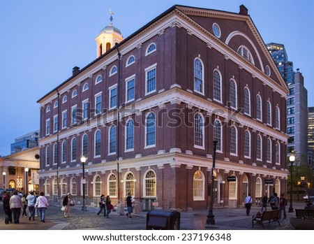 BOSTON, USA - JUNE 10: Panoramic view of the Georgian architecture of the famous Faneuil Hall in Boston, Massachusetts, USA at sunset with locals and tourists passing by on June 10, 2014. - stock photo