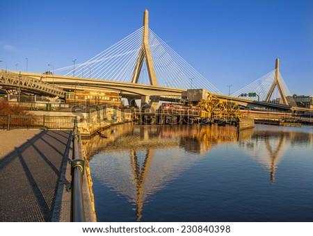 BOSTON, USA - NOVEMBER 10: Panoramic view of Boston in Massachusetts, USA showcasing the ultra modern architecture of the famous Zakim Bridge at sunset on November 10, 2014. - stock photo