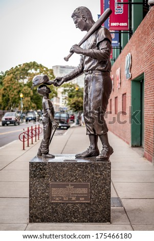 BOSTON, USA - SEPTEMBER 1: Famous Monument of Red Sox Baseball player Ted Williams located in front of the Fenway Park Stadium in Boston, Massachusetts, USA on September 1, 2013. - stock photo