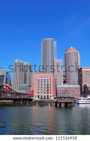 Boston waterfront with skyscrapers and boat in the morning. - stock photo