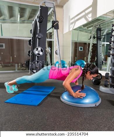 Bosu push up push-up woman at gym workout exercise - stock photo