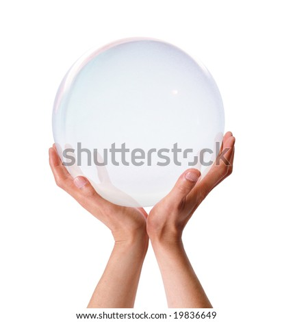 Both hands holding up a translucent ball - stock photo