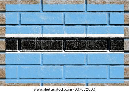 Botswana flag painted on old brick wall texture background - stock photo