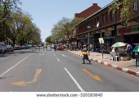 BOTSWANA, FRANCISTOWN, OCTOBER 28: Peoples on street in the second largest city in Botswana, October 27, 2014, Botswana - stock photo