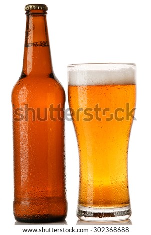 Bottle and glass of beer over white background