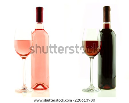 Bottle and glass of pink and red wine isolated - stock photo