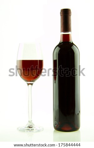 Bottle and glass of red wine isolated