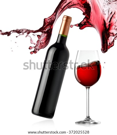 Bottle and glass of red wine splash - stock photo