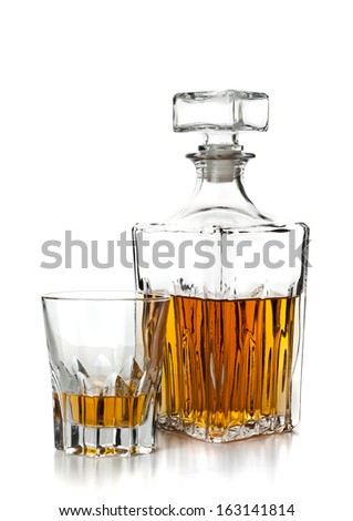 bottle and glass of whiskey on white background - stock photo